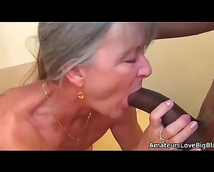 Grey haired granny enjoys large dark knob