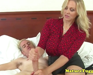 Busty older milf acquires cum on billibongs after hj