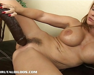 Busty milf janet taking each foot of a large brutal sex toy
