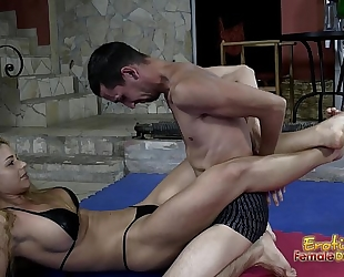 Victorious wrestling femdom-goddess jerks off her loser thrall