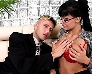 Horny secretary drilled on a sofa in underware