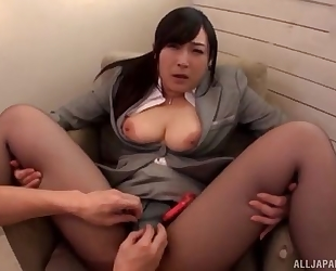 Asian slut serves hard pecker without taking off her pantyhose