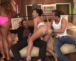 Four lusty bitches getting their eager holes drilled