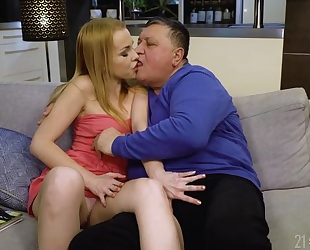 Blonde-haired cutie fucks chubby old man on the couch