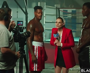 Two world-famous black boxers bang gorgeous reporter