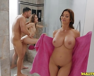 Seth bangs two lubricious hotties in the bathroom