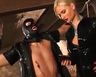 German blonde mistress punishes her submissive slaves