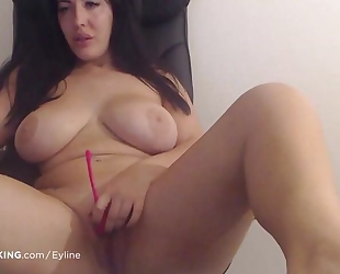 Chubby brunette brings herself to an eye-rolling orgasm