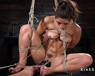 Hogtied playgirl tortured with sex tool